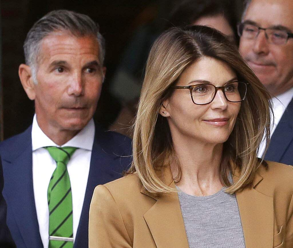 File photo: Lori Loughlin and Mossimo Giannulli (AP Photo/Steven Senne)