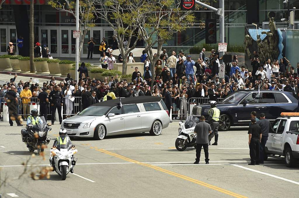 A silver hearse carrying the body of Ermias Asghedom aka Nipsey Hussle leaves Staples Center after the Celebration of Life memorial service for the late rapper. (Photo by Chris Pizzello/Invision/AP)