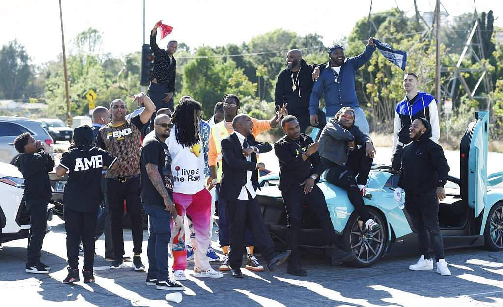 Attendees of a burial service for the late rapper Nipsey Hussle, including rapper YG, gather at Forest Lawn Hollywood Hills cemetery, Los Angeles. (Photo by Chris Pizzello/Invision/AP)