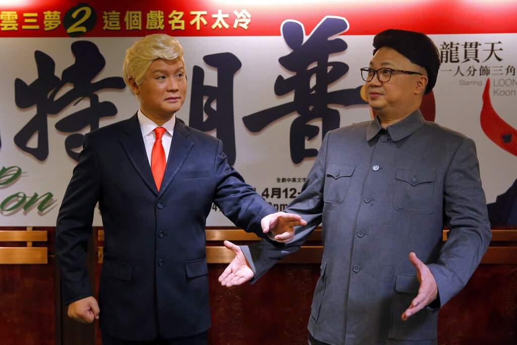 File photo: Hong Kong actors Chan Hung-chun and Lung Koon-tin dressed as Kim Jong Un and Donald Trump. (AP Photo/Kin Cheung, File)