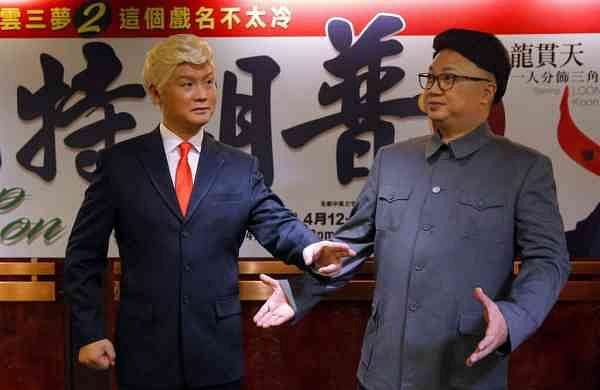 File photo: Hong Kong actors Chan Hung-chun and Lung Koon-tin dressed as Kim Jong Un and Donald Trump. (AP Photo/Kin Cheung, File)