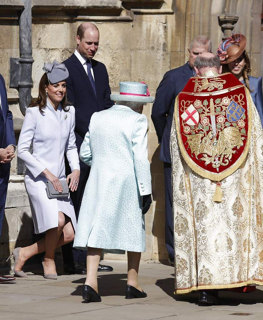 Britain's Kate, The Duchess of Cambridge curtsies as Britain's Queen Elizabeth II arrives to attend the Easter Mattins Service at St. George's Chapel, at Windsor Castle. (AP Photo/Kirsty Wigglesworth)