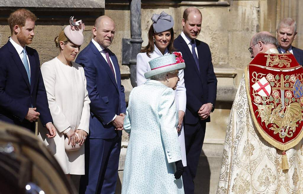 Members of Britain's Royal family watch as Queen Elizabeth II arrives to attend the Easter Mattins Service at St. George's Chapel, at Windsor Castle in England. (AP Photo/Kirsty Wigglesworth)
