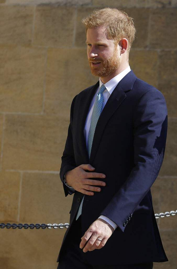 Britain's Prince Harry arrives to attend the Easter Mattins Service at St. George's Chapel, at Windsor Castle in England Sunday, April 21, 2019. (AP Photo/Kirsty Wigglesworth)