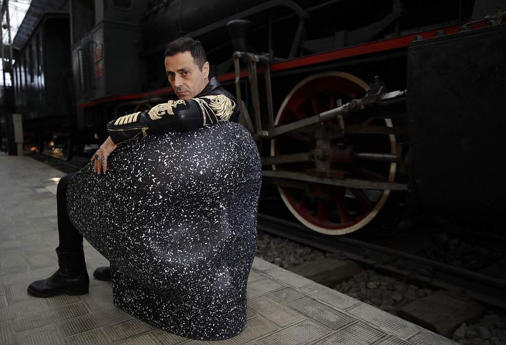 Italian designer Fabio Novembre on his 'Jolly Roger' chair of upcycled plastics, at the National Museum of Science and Technology, at the RO Plastic - Master's Pieces exhibition. (AP Photo/Luca Bruno)