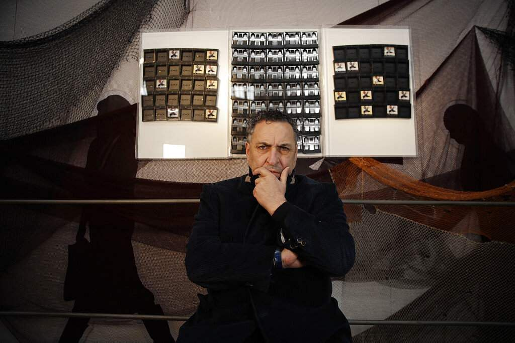Italian photographer Maurizio Galimberti with his creation of Polaroid cartridges, at the National Museum of Science and Technology, at the RO Plastic - Master's Pieces show. (AP Photo/Luca Bruno)