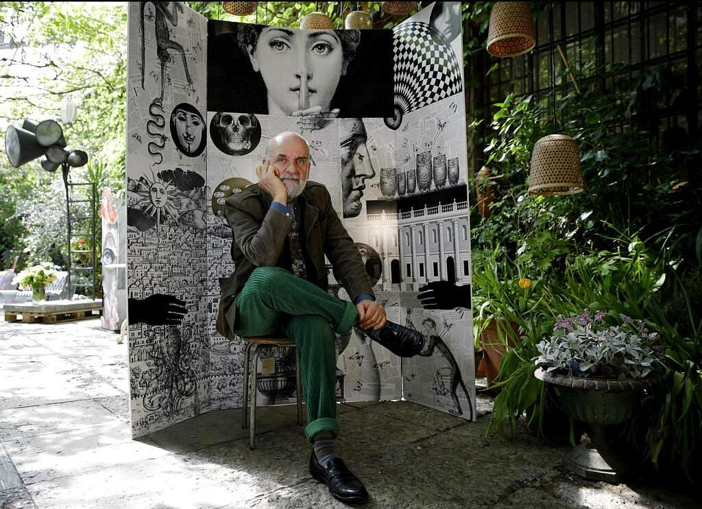 Design artistic director Barnaba Fornasetti poses in front of a paravent folding screen, Fornasettiana Remix, of regenerated polystyrene at the RO Plastic - Master's Pieces show. (AP Photo/Luca Bruno)