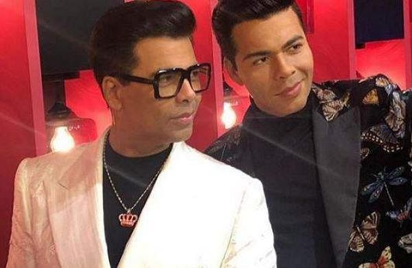 Karan Johar poses with his wax statue at Madame Tussauds