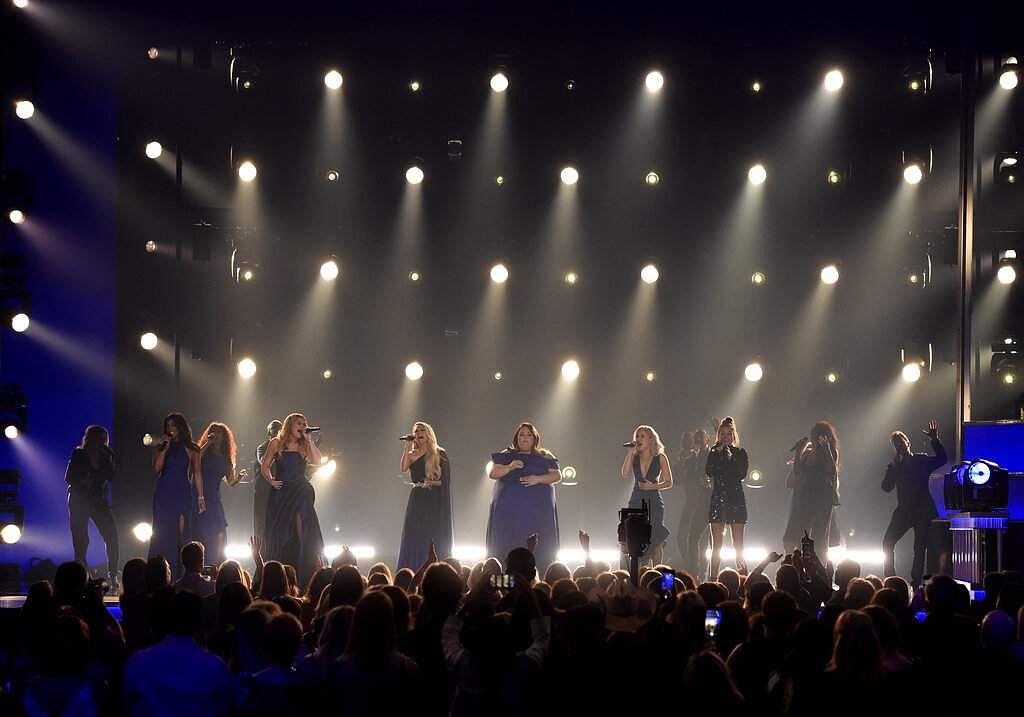 Mickey Guyton, Lauren Alaina, Carrie Underwood, Chrissy Metz and Maddie Marlow and Tae Dye, of Maddie & Tae, perform 'I'm Standing with You' in Las Vegas. (Photo by Chris Pizzello/Invision/AP)