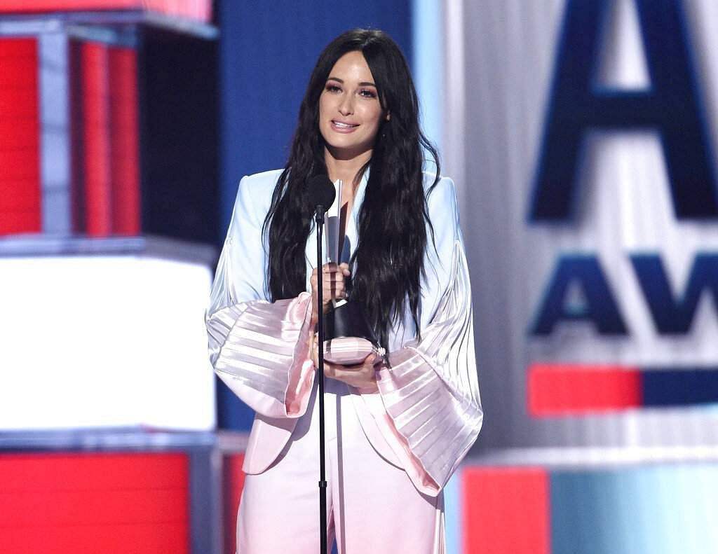 Kacey Musgraves accepts the award for female artist of the year at the 54th annual Academy of Country Music Awards in Las Vegas. (Photo by Chris Pizzello/Invision/AP)