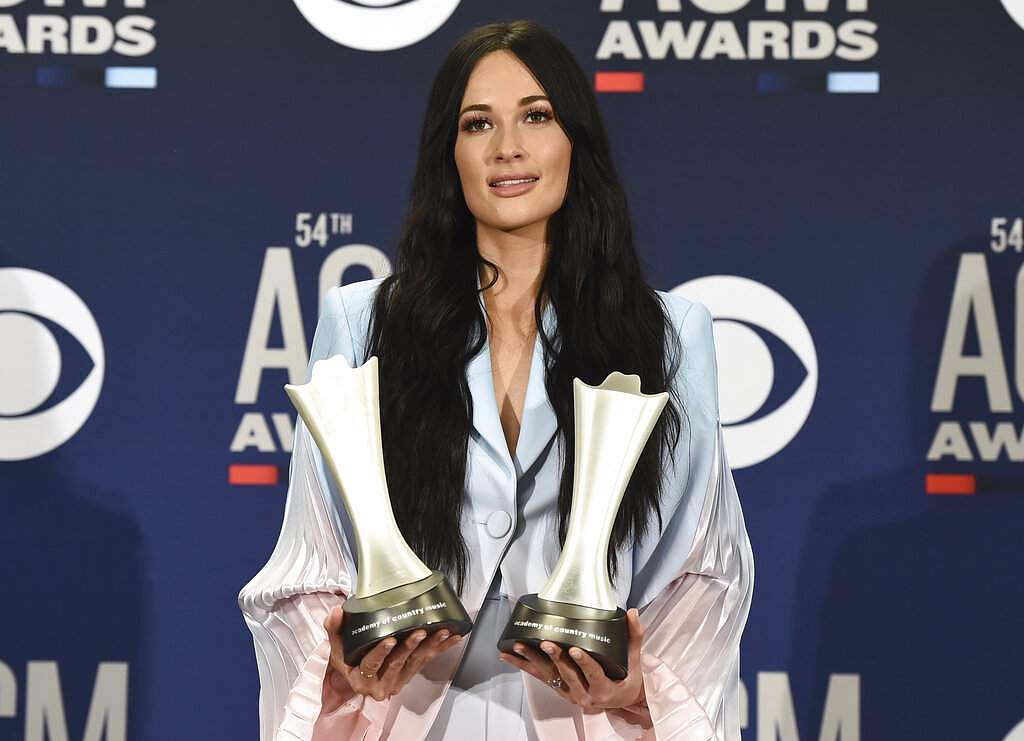 Kacey Musgraves with the awards for album of the year for 'Golden Hour' and female artist of the year at the 54th annual Academy of Country Music Awards. (Photo by Jordan Strauss/Invision/AP)