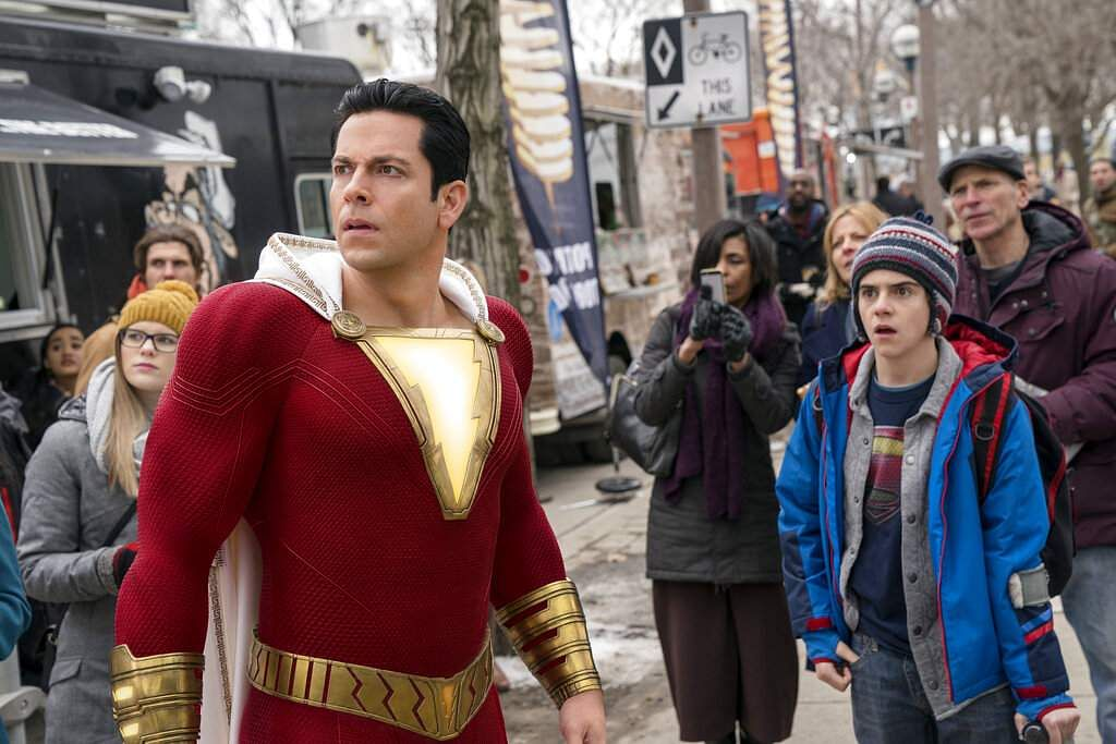 This image released by Warner Bros. shows Zachary Levi, left, and Jack Dylan Grazer in a scene from 'Shazam!' (Steve Wilkie/Warner Bros. Entertainment via AP)