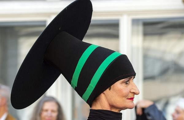 A woman dressed in a costume performs during the so-called Bauhaus Parade to celebrate the 100th anniversary of the Bauhaus movement in Weimar, Germany. (AP Photo/Jens Meyer)