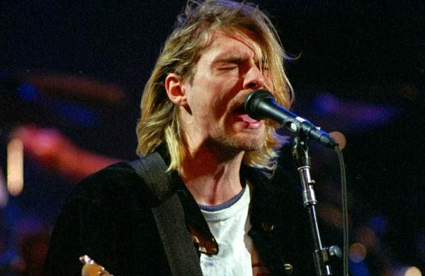 File photo, Kurt Cobain performs in Seattle in 1993 (AP Photo/Robert Sorbo, File)