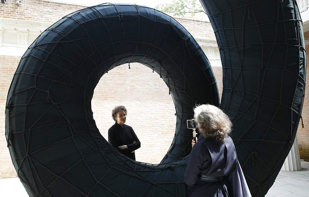 US curator Brooke Kamin Rapaport poses at the Liberty installation by Martin Puryear at the US pavilion of the 58th Biennale of Arts in Venice, Italy. (AP Photo/Antonio Calanni)