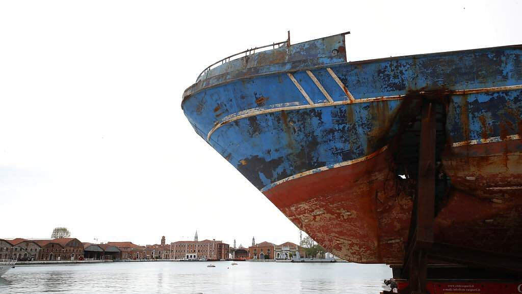Wreck of Barca Nostra, which sank in the Mediterranean Sea in 2015, at the 58th Biennale of Arts in Venice, Italy. This is a part of an installation by Christoph Büchel. (AP Photo/Antonio Calanni)