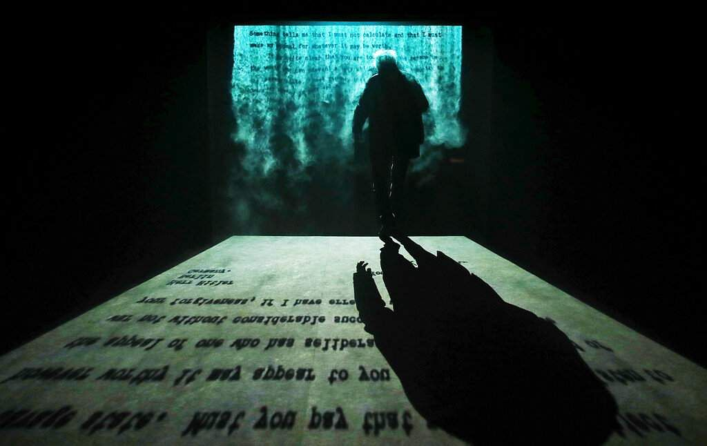 A man walks through the Fogscreen installation by Jitish Kallat at the India pavilion of the 58th Biennale of Arts in Venice, Italy. (AP Photo/Antonio Calanni)