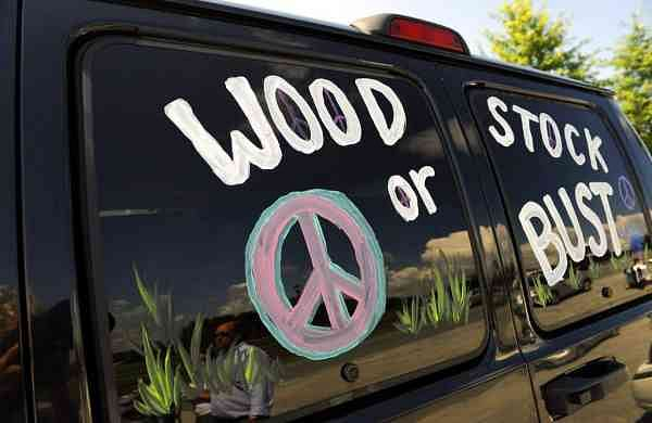 File photo: A van decorated with Woodstock or Bust. (AP Photo/Stephen Chernin)