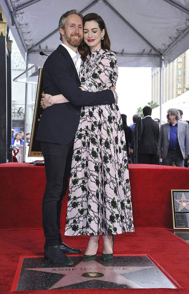Actress Anne Hathaway and her husband Adam Shulman hug following a ceremony honouring Hathaway with a star on the Hollywood Walk of Fame, in Los Angeles. (Photo by Richard Shotwell/Invision/AP)