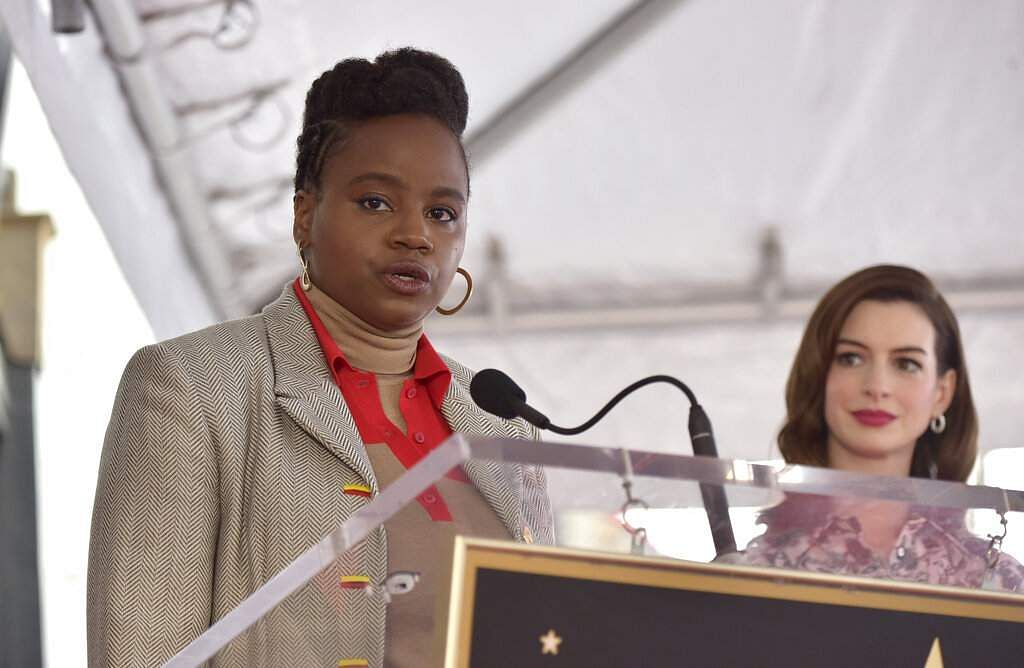 Writer/director Dee Rees speaks as actress Anne Hathaway looks on during a ceremony honouring Hathaway with a star on the Hollywood Walk of Fame in Los Angeles. (Photo by Richard Shotwell/Invision/AP)