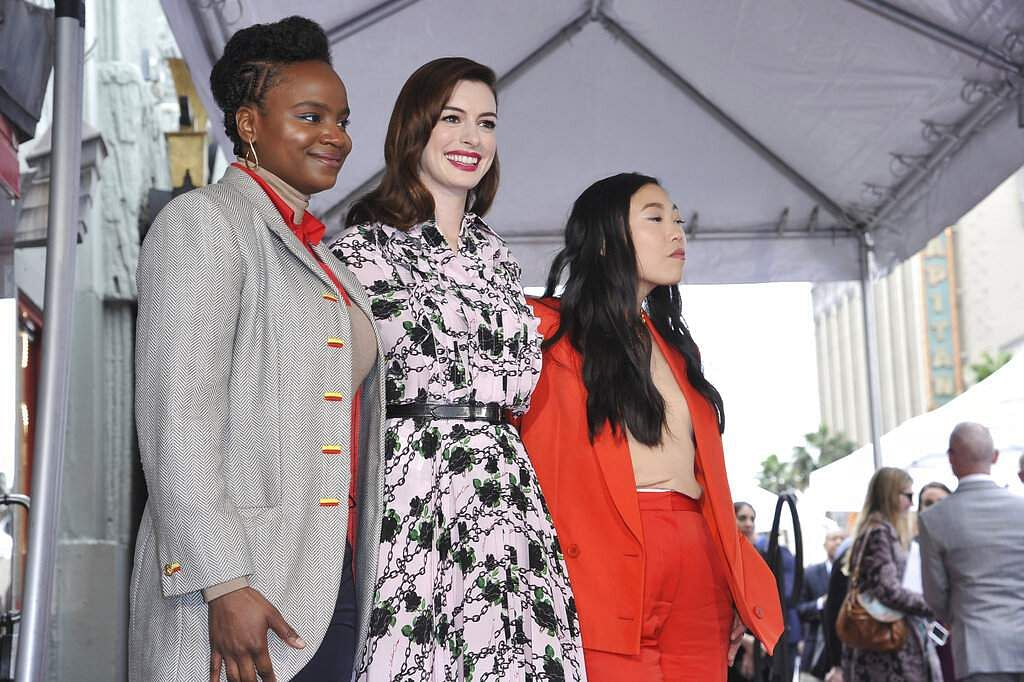 Anne Hathaway, writer/director Dee Rees and actress Awkwafina pose following a ceremony honouring Hathaway with a star on the Hollywood Walk of Fame. (Photo by Richard Shotwell/Invision/AP)