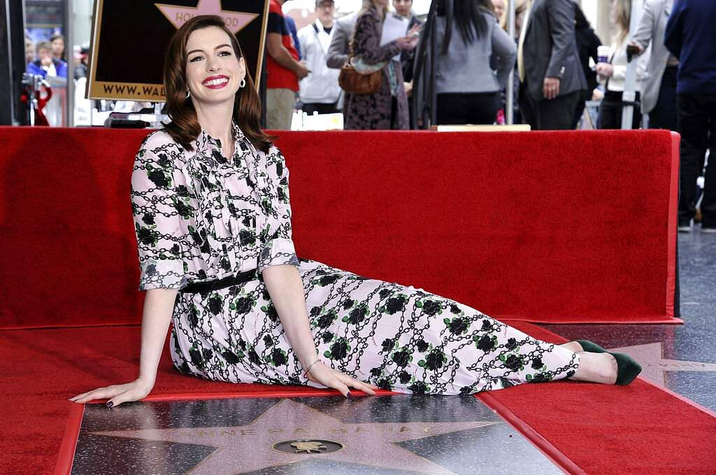Actress Anne Hathaway poses atop her new star on the Hollywood Walk of Fame following a ceremony in her honour on Thursday, May 9, 2019, in Los Angeles. (Photo by Richard Shotwell/Invision/AP)