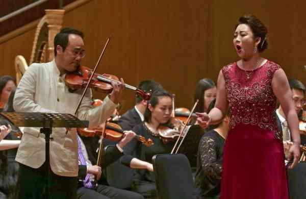 South Korean violinist Won Hyung Joon and his North Korean soprano partner Kim Song Mi perform at the Shanghai Oriental Arts Center in Shanghai on Sunday, May 12, 2019. (AP Photo/Dake Kang)