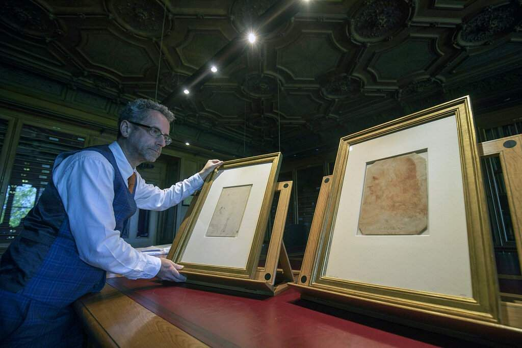 Martin Clayton, Head of prints and drawings at the Royal Collection Trust, reveals the drawing that has been confirmed as a portrait of Leonardo Da Vinci. (Steve Parsons/PA via AP)