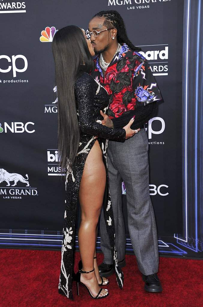 Saweetie, left, and Quavo kiss as they arrive at the Billboard Music Awards on Wednesday, May 1, 2019, at the MGM Grand Garden Arena in Las Vegas. (Photo by Richard Shotwell/Invision/AP)