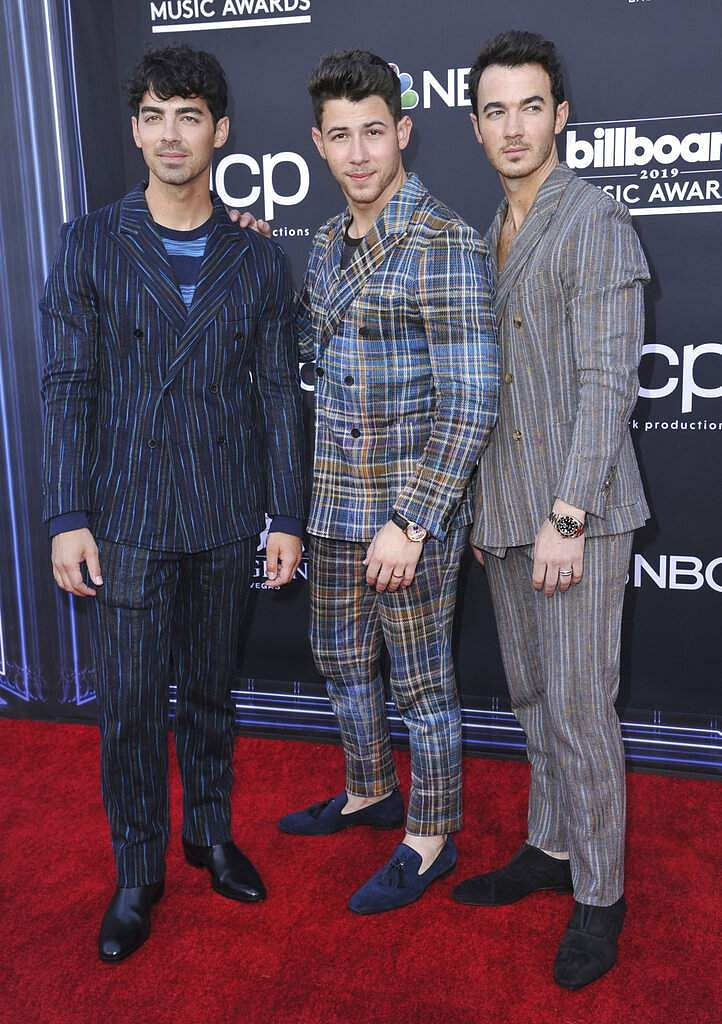 Joe Jonas, from left, Nick Jonas, and Kevin Jonas, of Jonas Brothers, arrive at the Billboard Music Awards at the MGM Grand Garden Arena in Las Vegas. (Photo by Richard Shotwell/Invision/AP)