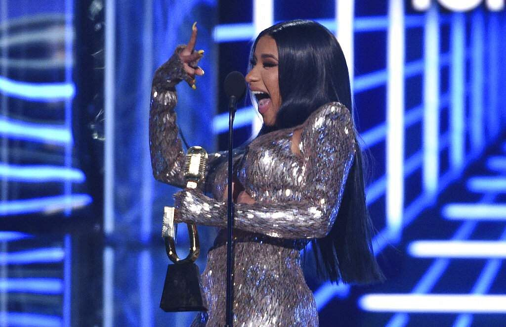 Cardi B gestures as she accepts the top rap song award for 'I Like It' at the Billboard Music Awards at the MGM Grand Garden Arena in Las Vegas. (Photo by Chris Pizzello/Invision/AP)