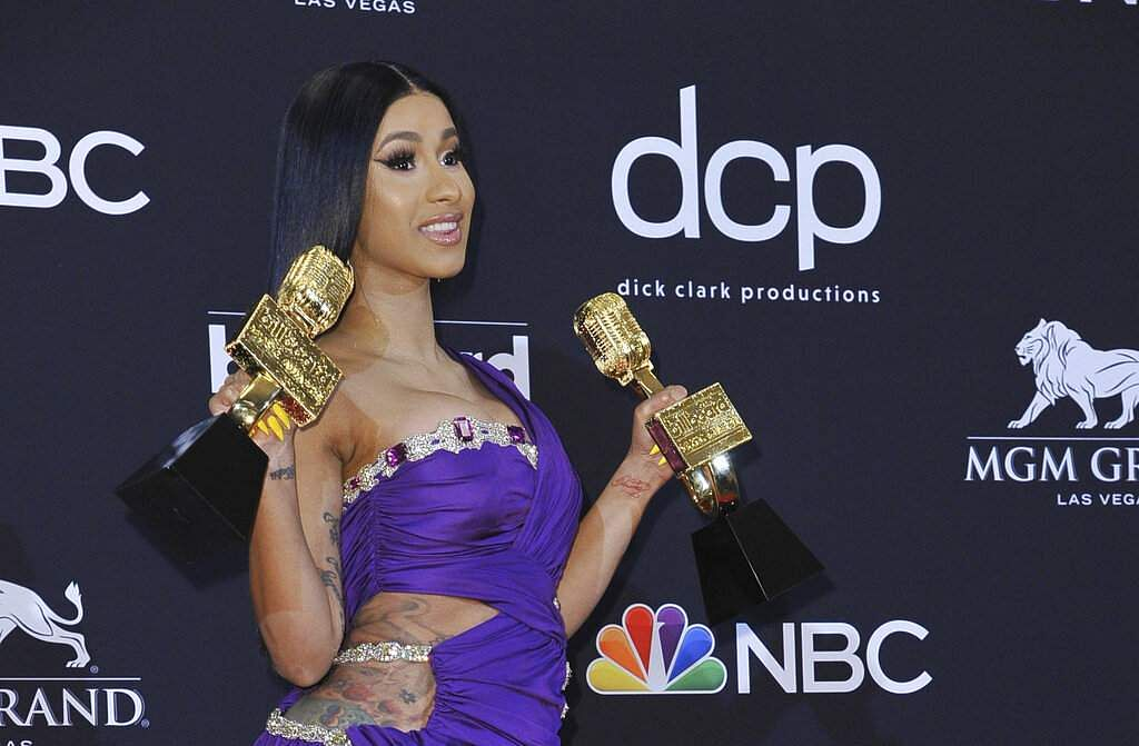 Cardi B poses with her awards at the Billboard Music Awards at the MGM Grand Garden Arena in Las Vegas. (Photo by Richard Shotwell/Invision/AP)