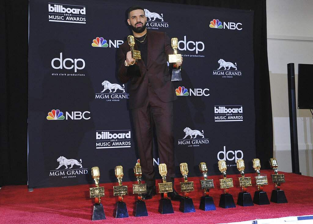 Drake poses in the press room with his awards at the Billboard Music Awards at the MGM Grand Garden Arena in Las Vegas. (Photo by Richard Shotwell/Invision/AP)