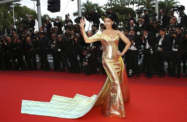 Actress Aishwarya Rai Bachchan poses for photographers upon arrival at the premiere of the film 'A Hidden Life'