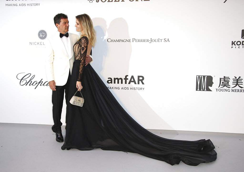 Actor Antonio Banderas and Nicole Kimpel pose at the amfAR, Cinema Against AIDS, benefit at Hotel du Cap-Eden-Roc at the 72nd Cannes film festival, in Cap d'Antibes. (Photo by Joel C Ryan/Invision/AP)