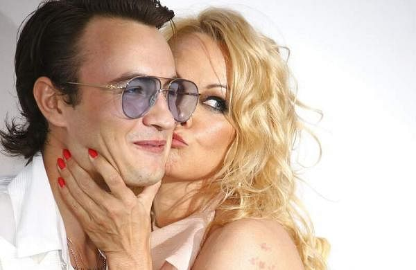 Actress Pamela Anderson kisses her son Brandon Thomas Lee at the amfAR, Cinema Against AIDS, benefit at the Hotel du Cap-Eden-Roc, at the 72nd Cannes film festival. (Photo by Joel C Ryan/Invision/AP)
