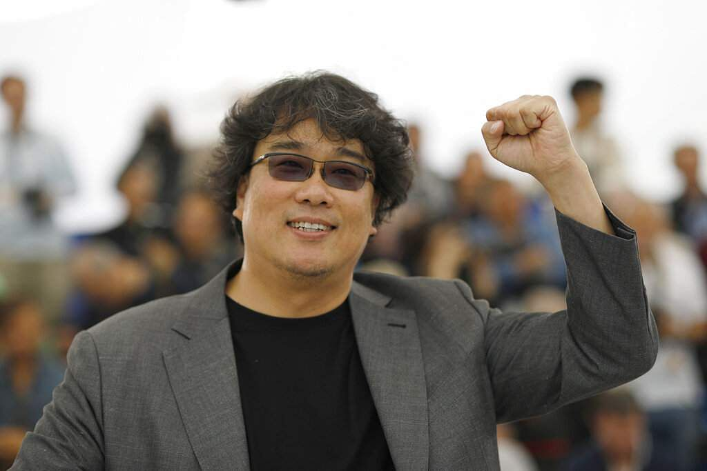 Director Bong Joon-ho poses at the photo call for the film 'Parasite' at the 72nd international film festival, Cannes, southern France, Wednesday, May 22, 2019. (AP Photo/Petros Giannakouris)