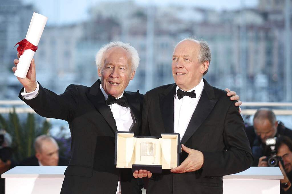 Directors Jean-Pierre Dardenne and Luc Dardenne hold their best director award for the film 'Young Ahmed' as they pose for a photo call at Cannes. (AP Photo/Petros Giannakouris)