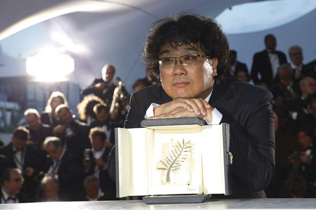 Director Bong Joon-ho poses with the Palme d'Or award for the film 'Parasite' during a photo call at Cannes. (Photo by Vianney Le Caer/Invision/AP)