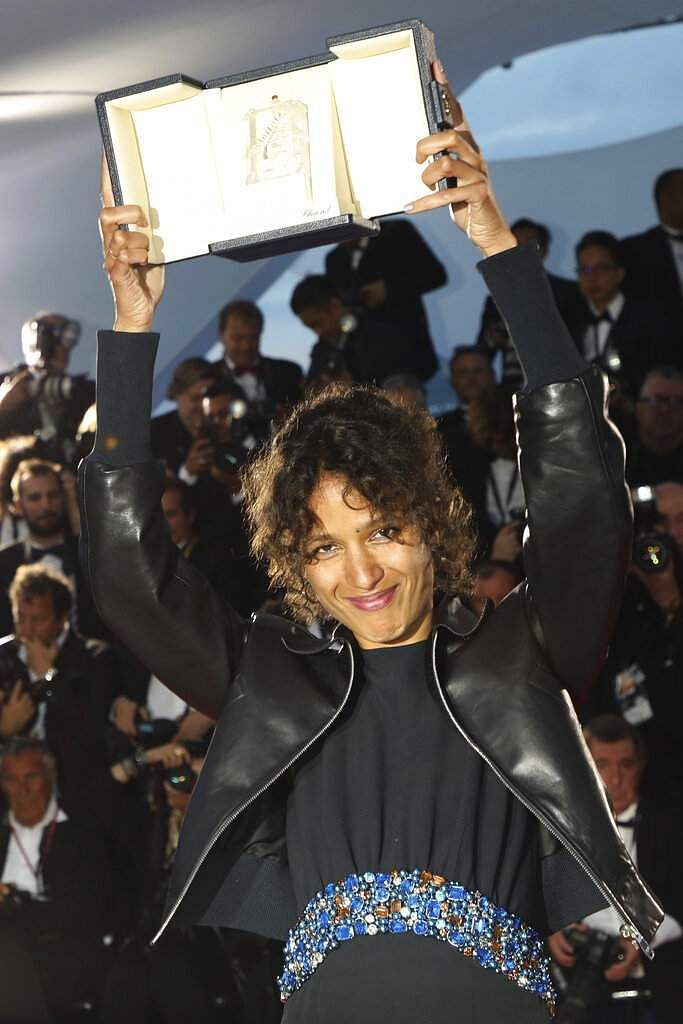 Director Mati Diop, winner of the grand prix award for the film 'Atlantique' poses for a photo call at Cannes. (Photo by Vianney Le Caer/Invision/AP)