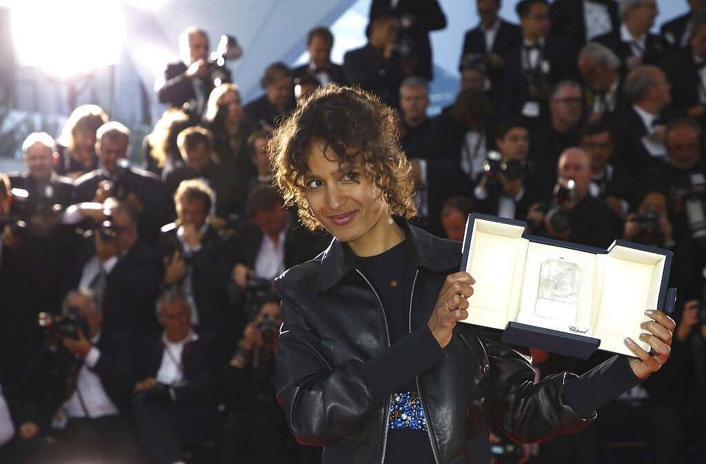 Director Mati Diop, winner of the grand prix award for the film 'Atlantique' poses during a photo call at Cannes. (Photo by Vianney Le Caer/Invision/AP)
