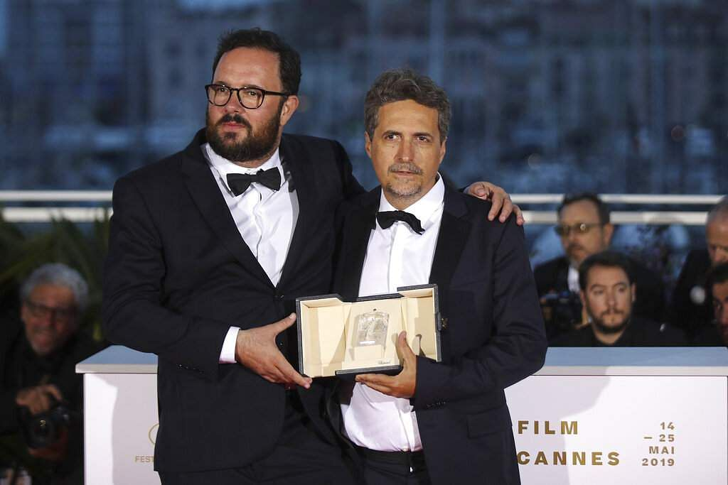 Directors Juliano Dornelles and Kleber Mendonca Filho, co-winners of the jury prize for the film 'Bacurau' pose for a photo call at Cannes. (AP Photo/Petros Giannakouris)