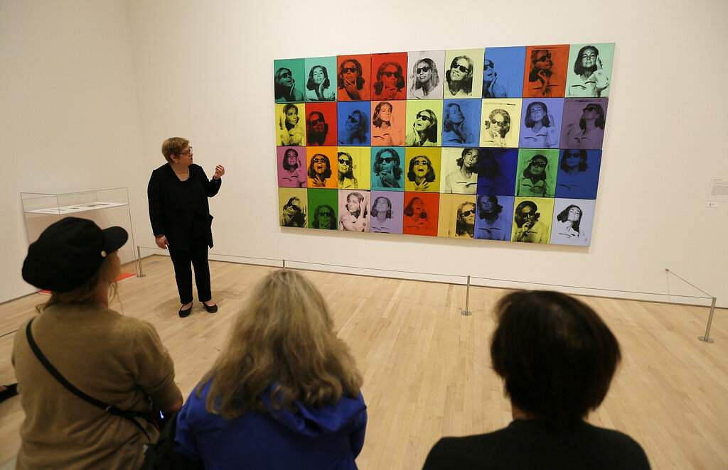 Donna DeSalvo, deputy director and senior curator at New York's Whitney Museum of American Art, talks about the piece 'Ethel Scull 36 Times'. (AP Photo/Eric Risberg)