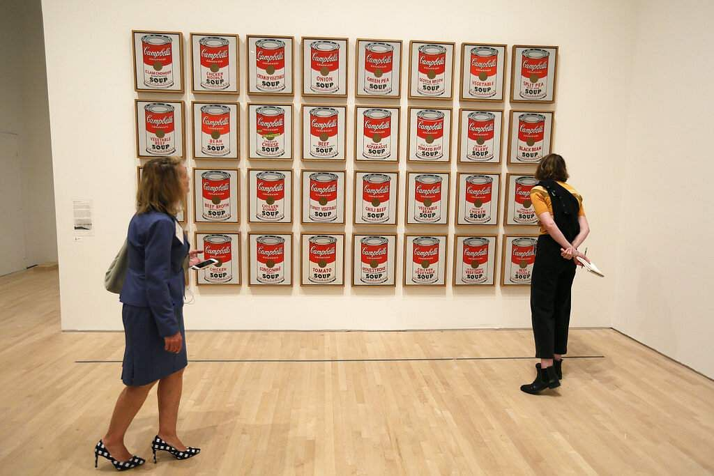 The 1962 pop piece 'Campbell's Soup Cans' at the exhibition, 'Andy Warhol _ From A to B and Back Again, in San Francisco. (AP Photo/Eric Risberg)