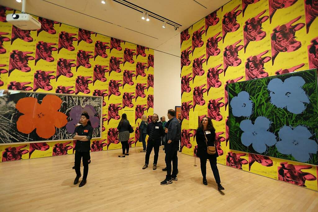 A room covered with 'Flowers' paintings and 'Cow Wallpaper' at the exhibition,' Andy Warhol _ From A to B and Back Again' in San Francisco.