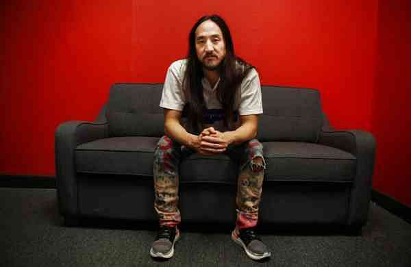 Steve Aoki sits for a portrait during a comic book signing of his new comic book series 'Neon Future' at Multiverse Corps. Comics on Thursday, May 2, 2019, in Miami. (AP Photo/Brynn Anderson)
