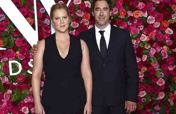 2018 file photo of Amy Schumer & Chris Fischer in New York (Photo by Evan Agostini/Invision/AP)