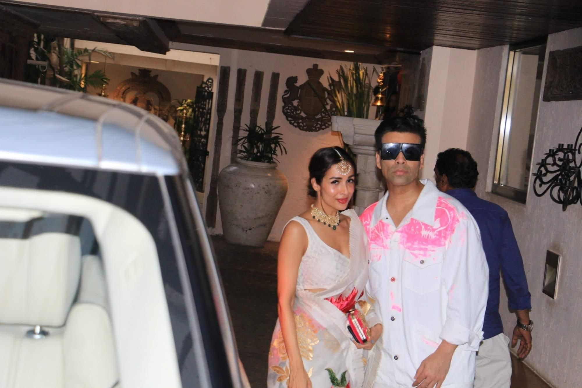 Actress Malaika Arora and filmmaker Karan Johar arrive to attend actress Sonam Kapoor's birthday party at Anil Kapoor's house in Mumbai on June 9, 2019. (Photo: IANS)