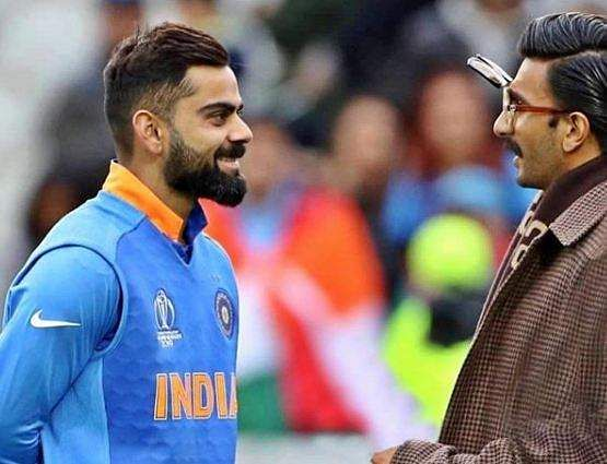 Ranveer Singh with Virat Kohli after the match against Pakistan
