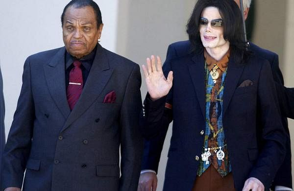 In this March 15, 2005 file photo, Michael Jackson leaves the Santa Barbara County Courthouse with his father, Joe Jackson, in Santa Maria, Calif. (AP Photo/Michael A. Mariant, File)